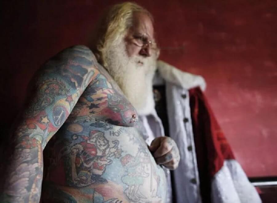 full body tattooed santa